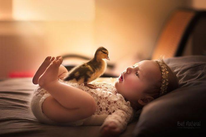04 foto di neonati con animali