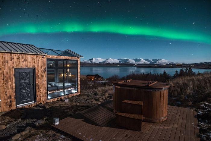 02 Ammirare l'aurora boreale in Islanda disteso su un comodo letto